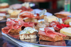 Meat and cheese canapes Stock Images