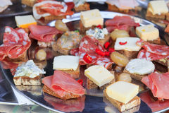 Meat and cheese canapes Royalty Free Stock Photos