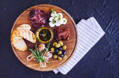 Meat and cheese plate antipasti snack stock images
