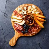 Meat and cheese plate Stock Photos