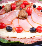 Meat and cheese plate detail Royalty Free Stock Photography