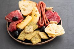 Meat and cheese plate.Traditional italian antipasto, cutting board with salami, cold smoked meat, prosciutto, ham. Cheeses, olives, capers. Cheese and meat royalty free stock photography