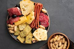 Meat and cheese plate.Traditional italian antipasto, cutting board with salami, cold smoked meat, prosciutto, ham. Cheeses, olives, capers. Cheese and meat royalty free stock images