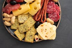 Meat and cheese plate.Traditional italian antipasto, cutting board with salami, cold smoked meat, prosciutto, ham. Cheeses, olives, capers. Cheese and meat royalty free stock photos