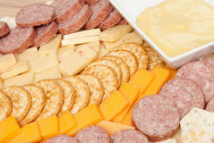 Meat and Cheese Platter. Including stone wheat crackers, wheat crackers, summer sausage, cheddar cheese, pepper jack cheese and a mustard sauce Royalty Free Stock Photo