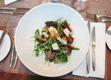 Meat and cheese salad on restaurant table Royalty Free Stock Images