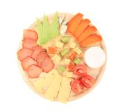 Meat and cheese on wooden platter. Royalty Free Stock Images