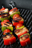 Meat, cherry tomato and red and green pepper skewe Stock Photo