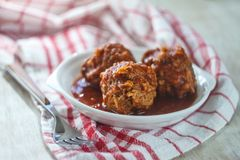 Meat, chicken meatballs in tomato sauce. Close-up. The concept of simple healthy and proper food.  stock photography