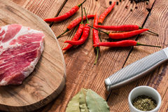 Meat with chili and some spices. Cooking lunch Stock Photos