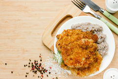 Meat chop in bread crumbs garnished with green buckwheat, hearty Royalty Free Stock Images