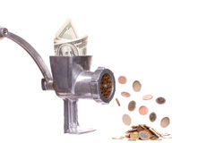 Meat chopper with dollars Stock Photos