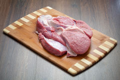 Meat on a chopping board Royalty Free Stock Images