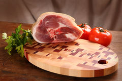 Meat on a chopping board Stock Image