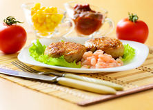 Meat chops with the peeled shrimp. Meat chops in the plate with the peeled shrimp Royalty Free Stock Image