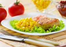 Meat chops with the peeled shrimp. Meat chops in the plate with the peeled shrimp Stock Photography