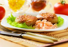 Meat chops with the peeled shrimp. Meat chops in the plate with the peeled shrimp Stock Photo