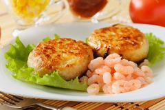 Meat chops with the peeled shrimp. Stock Images