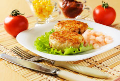 Meat chops with the peeled shrimp. Meat chops in the plate with the peeled shrimp Stock Photos