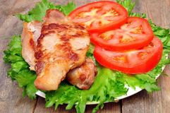 Meat chops with tomatoes Royalty Free Stock Image