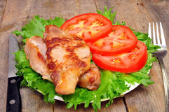 Meat chops with tomatoes Royalty Free Stock Images