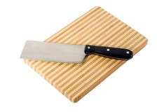 Meat-cleaver and chopping board Royalty Free Stock Images