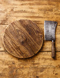 Meat cleaver and Chopping board. Butcher Meat cleaver and Chopping board block on wooden background royalty free stock photos