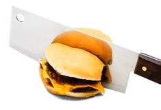 Meat Cleaver Cutting A Burger Stock Photo