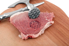 Meat cleaver in fresh pork chops. Isolated on white background stock photo