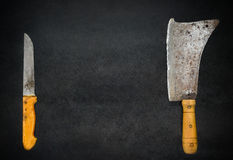 Meat Cleaver and Knife on Copy Space Area. Copy Space Text Area with Meat Cleaver and Knife on Dark Background stock image