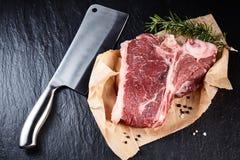 Meat cleaver beside raw steak Stock Photo