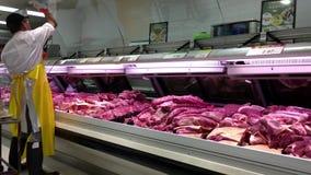 Meat clerk cleaning display fridge window stock footage