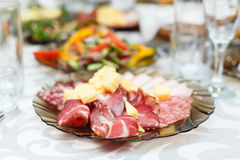 Meat cold cuts on a banquet table Royalty Free Stock Image