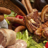 Meat composition- sausages, becon and black pudding Stock Image