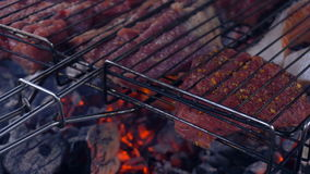 Meat is cooked on the coals stock video footage