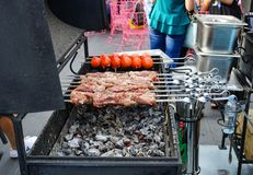 The meat is cooked grilled. Barbecue on the coals royalty free stock images