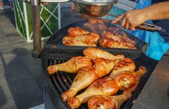 The meat is cooked grilled. Barbecue on the coals stock images