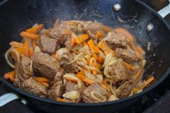Meat is cooked in a pot stock images