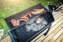 Meat cooking on barbecue grill for summer outdoor party Stock Images