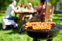 Meat cooking on barbecue grill at summer party Royalty Free Stock Image
