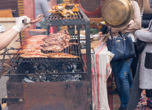 Meat cooking on outdoor grill over charcoal Royalty Free Stock Images