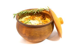 Meat in Cooking Pot. Clay Cooking Pot with meat isolated on white Stock Photo