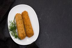 Meat croquetes on white dish Royalty Free Stock Photography