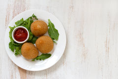 Meat croquette on white plate. On white background Royalty Free Stock Images