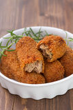 Meat croquettes in white dish on brown Stock Photo