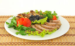 Meat, cut into slices beautifully decorated with lettuce . Royalty Free Stock Image