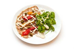 Meat cut from veal with sweet pepper and arugula with sauce royalty free stock photo