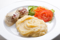Meat cutlet with mashed potatoes and fresh salad Royalty Free Stock Images