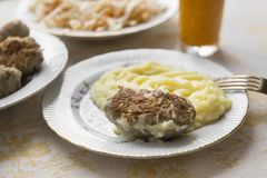 Meat cutlet with mashed potatoes on a plate, fork. Plates with food royalty free stock photography
