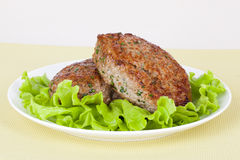 Meat cutlet on a plate. With fresh green salad stock images